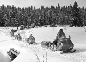 A group of vintage snowmobiles in the Allagash Maine wilderness